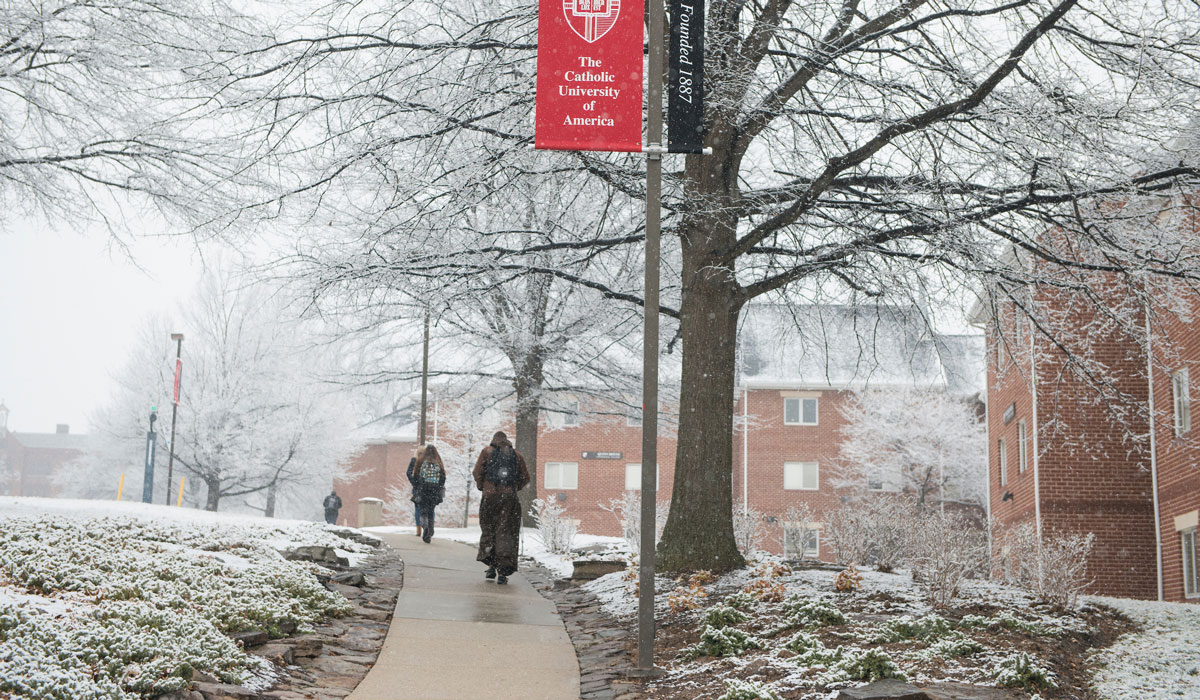 Students walking across campus in the snow